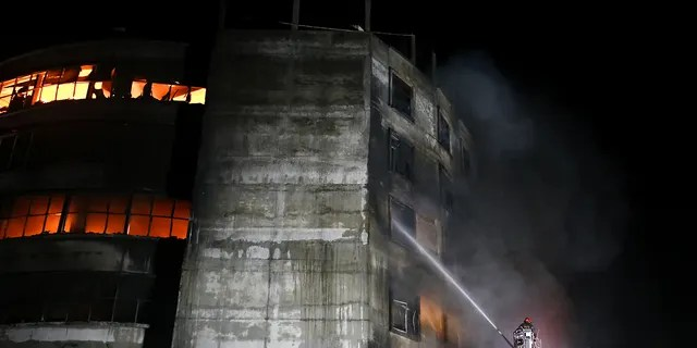 DHAKA, BANGLADESH - 2021/07/09: Firefighters work to extinguish fire at a factory called Hashem Foods Ltd. in Rupganj, Narayanganj district on the outskirts of Dhaka. (Photo by Md. Mir Hossen Roney/Pacific Press/LightRocket via Getty Images)