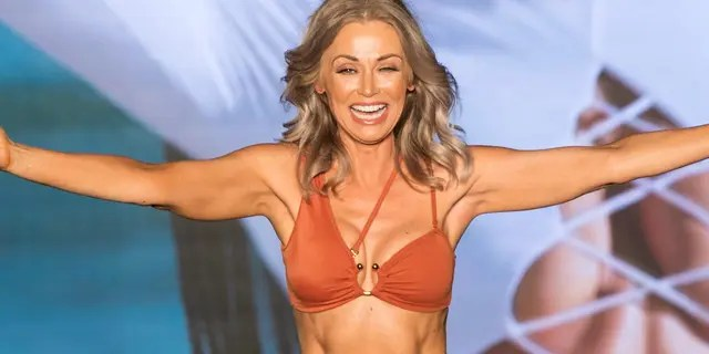 Kathy Jacobs walks the runway during the 2021 Sports Illustrated Swimsuit Runway Show.