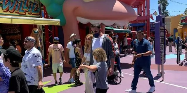 The Hollywood actors were accompanied by bodyguards while they explored the Los Angeles theme park, according to SWNS. Lopez and Affleck reportedly took their kids to the park's Simpsons Ride. (Credit: SWNS)