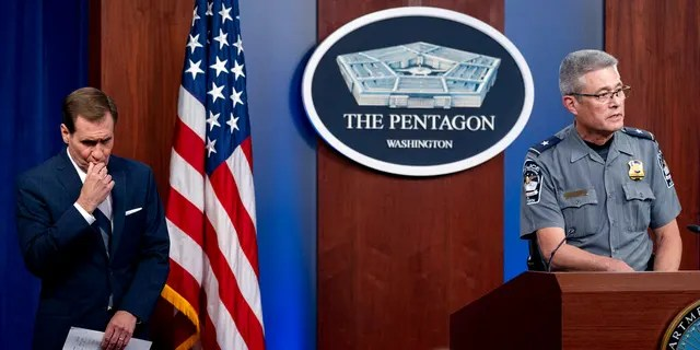 Pentagon Police Chief Woodrow Kusse, right, accompanied by Pentagon spokesman John Kirby, left, speaks during a briefing at the Pentagon in Washington, Tuesday, Aug. 3, 2021.