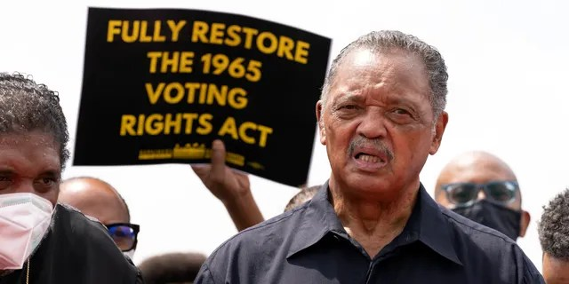FILE - In this Monday, Aug. 2, 2021 file photo, Rev. Jesse Jackson speaks to the crowd during a demonstration supporting the voting rights, on Capitol Hill, in Washington. The Rev. Jesse Jackson and his wife, Jacqueline, have been hospitalized after testing positive for COVID-19 according to a statement Saturday, Aug. 21, 2021. He is vaccinated against the virus and publicly received his first dose in January. According to a statement released Saturday evening, the Jacksons are being treated at Northwestern Memorial Hospital in Chicago. He is 79 years old. Jacqueline Jackson is 77. (AP Photo/Jose Luis Magana, File)