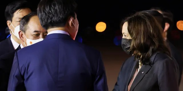 U.S. Vice President Kamala Harris is welcomed by Chairman of the Office of State President Le Khanh Hai, as she arrives for the second leg of her Asia trip, in Hanoi, Vietnam, Tuesday, Aug. 24, 2021. (Associated Press)