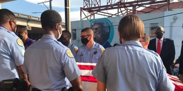 New Orleans police officers hold a casket with Det. Everett Briscoe's body. Briscoe was killed this past weekend while visiting Houston with members of the Zulu Social Aid and Pleasure Club.