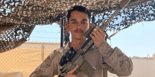 Kareem Nikoui, a young U.S. Marine, poses with his rifle. Nikoui was killed in suicide bombing in Kabul, Afghanistan, on 8/26/21