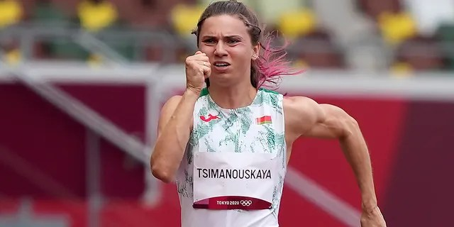 Krystsina Tsimanouskaya, of Belarus, runs in the women's 100-meter run at the 2020 Summer Olympics, Friday, July 30, 2021.