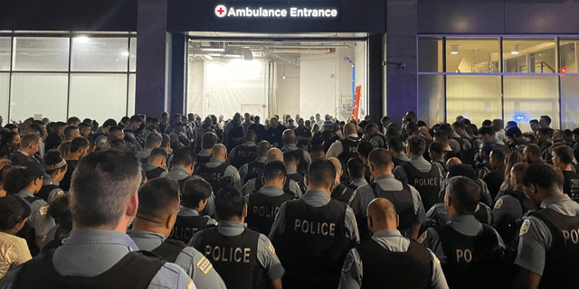 Chicago police officers gather overnight outside the University of Chicago Medical Center, where one officer died and another remained hospitalized after Saturday's shooting incident. (Chicago Police)