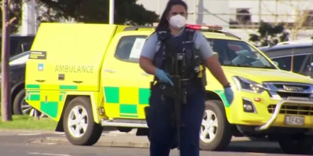 A police officer stands guard outside an Auckland supermarket on Friday, Sep. 3, 2021. New Zealand authorities say they shot and killed a violent extremist after he entered a supermarket and stabbed and injured six shoppers. Prime Minister Jacinda Ardern described Friday's incident as a terror attack.