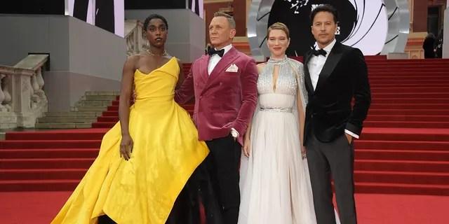 (L to R) Lashana Lynch, Daniel Craig, Lee Seydoux and director Cary Fukunaga attend the world premiere of