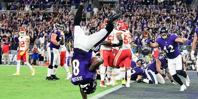 Baltimore Ravens quarterback Lamar Jackson (8) flips into the end zone for a fourth quarter touchdown against the Kansas City Chiefs at M&T Bank Stadium.