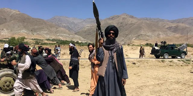 Taliban soldiers stand guard in Panjshir province northeastern of Afghanistan, Wednesday, Sept. 8, 2021.