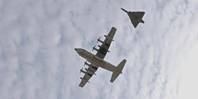 A U.S. KC-130J Super Hercules, with Combined Joint Task Force - Horn of Africa, and two French Dassault Mirage 2000's perform a combined flyover with during a Patriot's Day ceremony at Camp Lemonnier, Djibouti, Sept. 11, 2021, commemorating the 20th anniversary of the terrorist attacks on the United States on Sept. 11, 2001. The memorial ceremony included a joint formation, a multi-aircraft flyover, presentation of colors and the playing of Taps. Camp Lemonnier held multiple events in honor and remembrance of those who lost their lives both on that day and over the past two decades fighting the Global War on Terror.