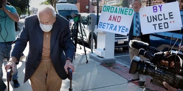 Former Cardinal Theodore McCarrick, left, arrives at Dedham District Court, Friday, Sept. 3, 2021, in Dedham, Mass. (AP Photo/Michael Dwyer)