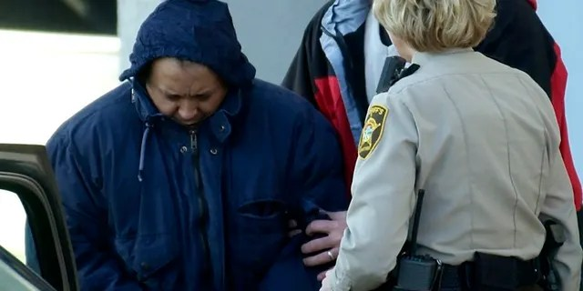 In this Dec. 3, 2003 file photo, Alfonso Rodriguez Jr., left, is helped into a sheriff's car after waiving extradition at the Polk County Courthouse in Crookston, Minnesota.