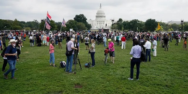 People attend a rally near the U.S. Capitol in Washington, Saturday, Sept. 18, 2021.