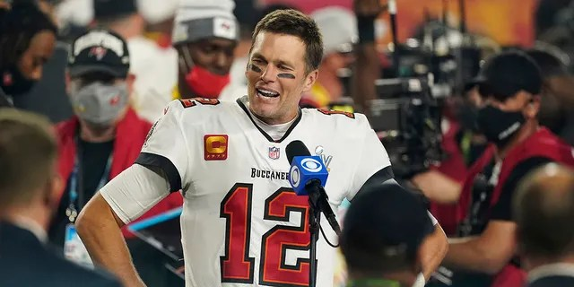Tampa Bay Buccaneers quarterback Tom Brady is interviewed on the field after the the 2021 Super Bowl game with the Kansas City Chiefs in Tampa, Fla., Feb. 7, 2021.