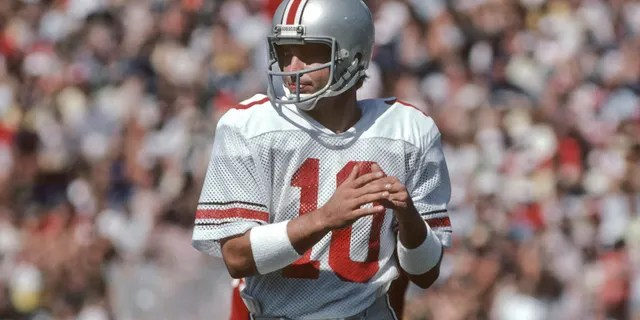 Art Schlichter #10 of the Ohio State Buckeyes calls a timeout during an NCAA football game against Stanford University played on September 26, 1981 at Stanford Stadium in Palo Alto, California. (Photo by David Madison/Getty Images)