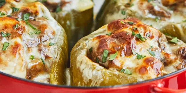 """The Cheesesteak-Stuffed Peppers with Wild Rice from Cassy Joy Garcia's new cookbook """"Cook Once Dinner Fix: Quick and Exciting Ways to Transform Tonight's Dinner into Tomorrow's Feast"""" is pictured."""