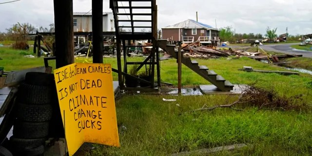 Storm clouds from Tropical Storm Nicholas are seen behind homes of the vanishing Native American community of Isle de Jean Charles, La., which were destroyed by Hurricane Ida, Tuesday, Sept. 14, 2021.