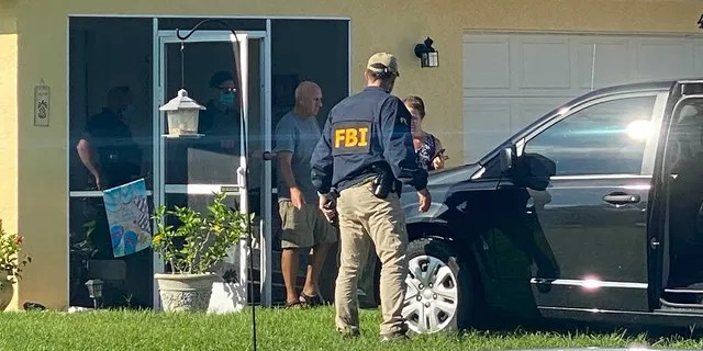 Christopher and Roberta Laundrie exit their home as FBI agents execute a search warrant at their Florida home, Monday, Sept. 20, 2021. (Photo: Paul Best/Fox News)