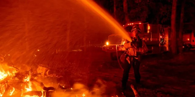 Firefighter Ron Burrias battles the Fawn Fire on Thursday, September 23, 2021, in Shasta County, north of Redding, Calif.