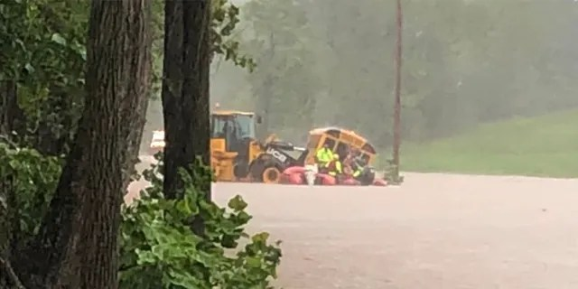 10 students and a driver were rescued off this flooded school bus in western Maryland.