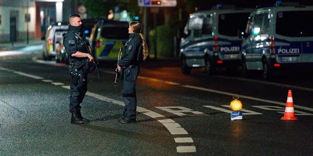 Police officers block a street in the city center during a police operation protecting the Jewish Community building in Hagen, Germany, Thursday, Sept. 16, 2021.