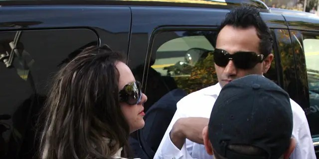 Britney Spears arrives with her boyfriend Adnan Ghalib (R) at the Los Angeles County Superior courthouse 14 January 2008 for a hearing regarding visitation rights for her two sons that she has with ex-husband Kevin Federline.