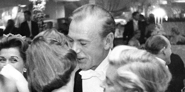 Gary Cooper with his wife, Veronica Balfe, and daughter, Maria Cooper, at a New Year's party held at Romanoff's in Beverly Hills, Calif., Dec. 31, 1957.