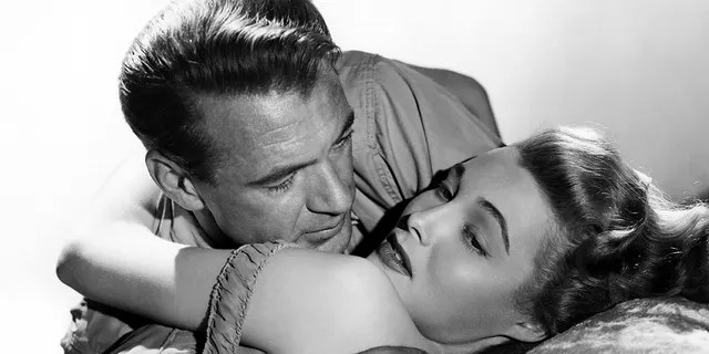 """Actress Patricia Neal and Gary Cooper in a scene from the movie """"The Fountainhead"""""""