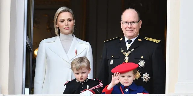 Princess Charlene of Monaco and Prince Albert II of Monaco with children Prince Jacques of Monaco and Princess Gabriella of Monaco pose at the Palace balcony during the Monaco National Day Celebrations on November 19, 2019 in Monte-Carlo, Monaco.