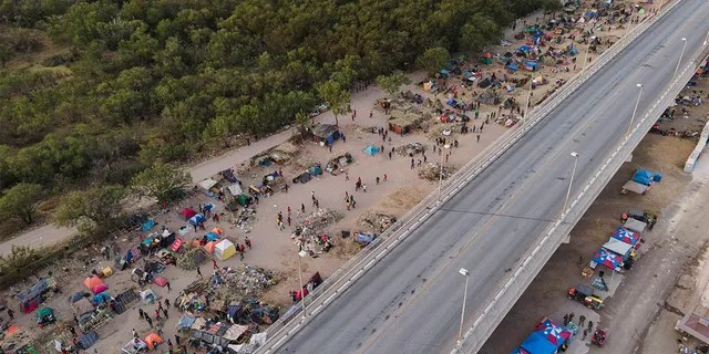 Migrants, many from Haiti, are seen at an encampment along the Del Rio International Bridge, Wednesday, Sept. 22, 2021, in Del Rio, Texas. (Associated Press)