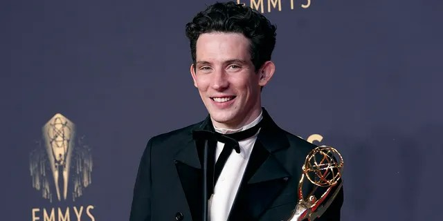 """Josh O'Connor, winner of the award for outstanding lead actor in a drama series for """"The Crown"""" poses at the 73rd Primetime Emmy Awards on Sunday, Sept. 19, 2021, at L.A. Live in Los Angeles."""