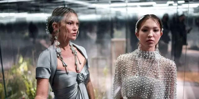 British model Kate Moss and her daughter Leila Grace Moss-Hack present creations by British designer Kim Jones for Fendi's Spring-Summer collection during Paris Haute Couture Fashion Week on January 27, 2021 in Paris.