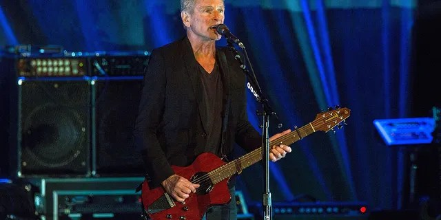 Buckingham is set to release a self-titled solo album on Friday and said that some of his songs took on new meaning amid his marital struggles.