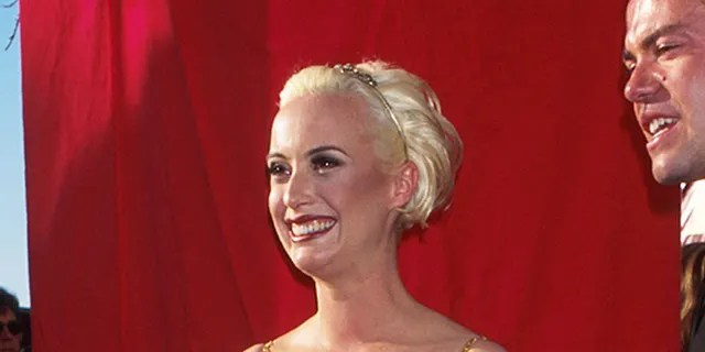 Lizzy Gardiner attends the Academy Awards in 1995.