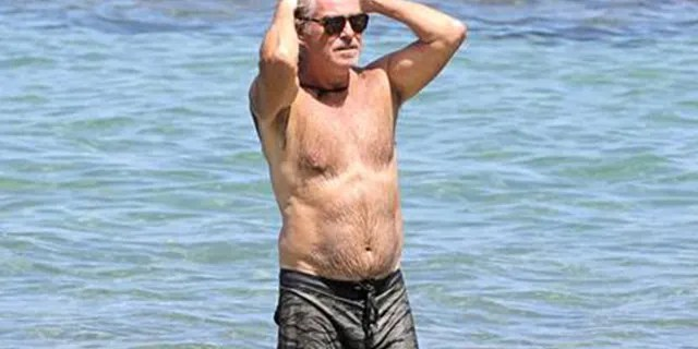 Pierce Brosnan went shirtless during a trip to the beach in Hawaii.