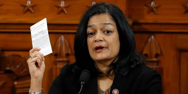 WASHINGTON, DC - DECEMBER 13: Holding up a copy of the U.S. Constitution, Rep. Pramila Jayapal, D-Wash., votes to approve the second article of impeachment as the House Judiciary Committee holds a public hearing to vote on the two articles of impeachment against U.S. President Donald Trump (Photo by Patrick Semansky-Pool/Getty Images)