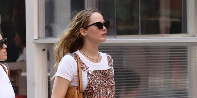 Pregnant Jennifer Lawrence seen for the first time showing a baby bump after having lunch in Manhattan's Downtown area.