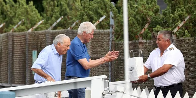Pictured: Bill Clinton,Alfonso Fanjul Ref: SPL5250460 310821 EXCLUSIVE Picture by: Matt Agudo / SplashNews.com Splash News]