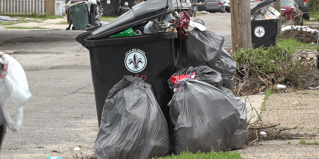 Trash bins in New Orleans are filled to the brim as city sanitation workers struggle to keep up with the demand for trash pick-up following Hurricane Ida.