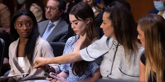 U.S. Olympic gymnasts Simone Biles, McKayla Maroney, Aly Raisman and Maggie Nichols arrive to testify during a Senate Judiciary hearing about the Inspector General's report on the FBI handling of the Larry Nassar investigation of sexual abuse of Olympic gymnasts, on Capitol Hill, in Washington, D.C., Sept. 15, 2021.