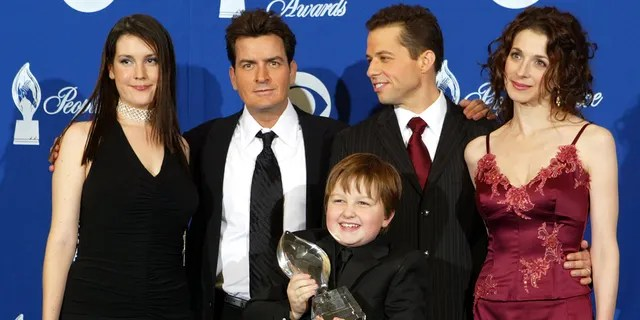 The winners of 'Favorite New Television Comedy', the cast of 'Two and a Half Men', (LR) Melanie Lynskey, Charlie Sheen, Angus T Jones, Jon Cryer and Marin Hinkle stand behind the scenes at the 30th annual People's Choice Awards at Pasadena Civic Auditorium January 11, 2004 in Pasadena, California.