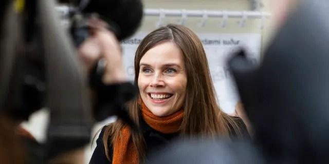 Iceland's Prime Minister Katrin Jakobsdottir speaks to the media after voting at a polling station in Reykjavik, Iceland, Saturday, Sept. 25, 2021. (AP Photo/Arni Torfason)