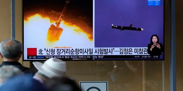 People watch a TV screen showing a news program reporting about North Korea's long-range cruise missiles tests with images in Seoul, South Korea, on Monday. (Associated Press)
