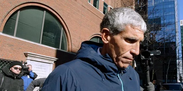 """In this March 12, 2019, file photo, William """"Rick"""" Singer, founder of the Edge College & Career Network, departs federal court in Boston after he pleaded guilty to charges in a nationwide college admissions bribery scandal. (AP Photo/Steven Senne, File)"""