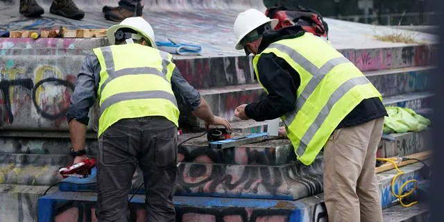 Crews attempt to locate a time capsule said to be buried in the base of the statue of on Monument Avenue in Richmond, Va., Thursday, Sept. 9, 2021. The statue was removed from the pedestal on Wednesday. (AP Photo/Steve Helber)
