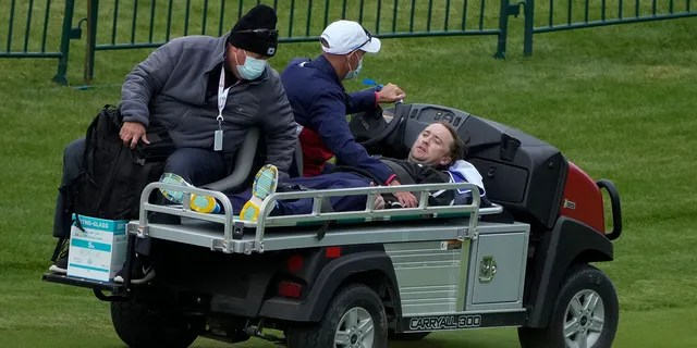 Actor Tom Felton is helped after collapsing on the 18th hole during a practice day at the Ryder Cup at the Whistling Straits Golf Course Thursday, Sept. 23, 2021, in Sheboygan, Wis. (Associated Press)
