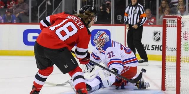 New Jersey Devils center Dawson Mercer (18) shoots the puck wide of New York Rangers goaltender Adam Huska (32) during the second period Oct. 1, 2021, at Prudential Center in Newark, New Jersey.