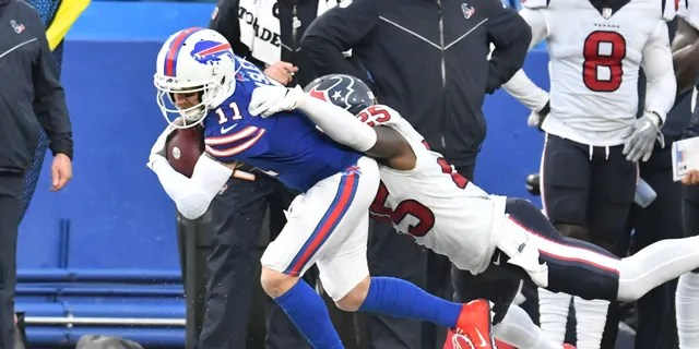 Buffalo Bills wide receiver Cole Beasley (11) is tackled by Houston Texans defensive back Desmond King (25) after a catch in the second quarter at Highmark Stadium.
