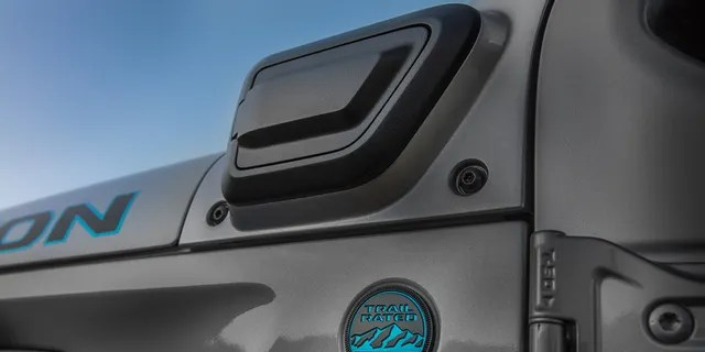 The Wrangler 4xe's charge port is unmarked.